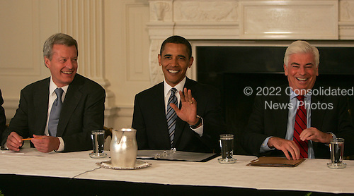 Washington, DC - June 2, 2009 -- United States President Barack Obama jokes with the press as he meets with Senate Democrats to discuss health care legislation. The meeting was held in the State Dining Room of the White House on Tuesday, June 2, 2009. Left to right: U.S. Senator Max Baucus (Democrat of Montana); President Obama; and U.S. Senator Christopher Dodd (Democrat of Connecticut). .Credit: Dennis Brack / Pool via CNP