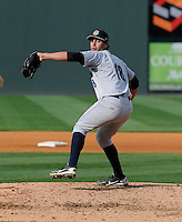 Pitcher Gabriel Encinas (18) of the Charleston RiverDogs in a game against the Greenville Drive on Sunday, April 7, 2013, at Fluor Field at the West End in Greenville, South Carolina. Charleston won, 5-0. Encinas is the No. 30 prospect for the New York Yankees, according to Baseball America. (Tom Priddy/Four Seam Images)  .