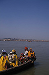 Pilgrims on a boat at the Sangam.It was estimated that 30 million pilgrims visited the Maha Kumbha Mela in 1989 making it the largest gathering of any kind in modern history.Sadhus holy men and pilgrims come to bathe at the Sangam where the Ganges,Yamuna and Saraswati Rivers meet. Maha Kumbha Mela is held every twelve years at Prayag (Allahabad) in Uttar Pradesh in India.
