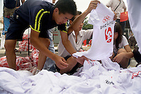 People look through Olympic- and Chinese-themed t-shirts sold by street vendors near the route of the Nanjing, China, leg of the 2008 Olympic Torch Relay.  .