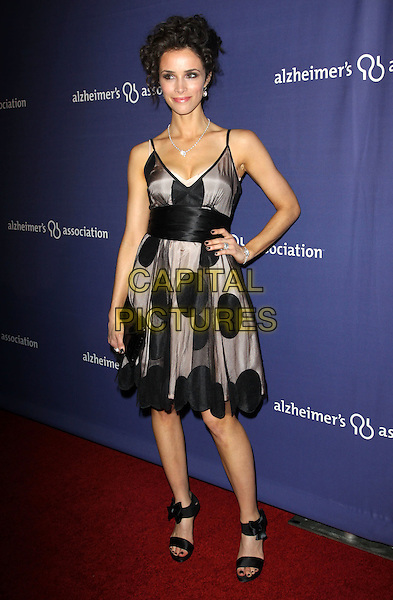 "ABIGAIL SPENCER .18Th Annual ""A Night at Sardi's"" Benefitting The Alzheimer's Association held At The Beverly Hilton Hotel, Beverly Hills, California, USA..March 18th, 2010.full length black polka dot grey gray beige sheer dress hand on hip.CAP/ADM/KB.©Kevan Brooks/AdMedia/Capital Pictures."