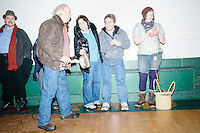 People wait for the arrival of Vermont senator and Democratic presidential candidate Bernie Sanders before he speaks to senior citizens at the Peterborough Community Center gymnasium in Peterborough, New Hampshire.