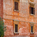 a wonderfully textured wall with rusty-orange tones