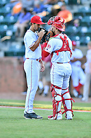 Greeneville Reds starting pitcher Lyon Richardson (16) and catcher Ernesto Liberatore (41) go over the signals before a game against the Bluefield Blue Jays at Pioneer Park on June 30, 2018 in Greeneville, Tennessee. The Blue Jays defeated the Red 7-3. (Tony Farlow/Four Seam Images)