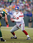 New York Giants quarterback Eli Manning (10) looks for a receiver during an NFL divisional playoff football game against the Green Bay Packers on January 15, 2012 in Green Bay, Wisconsin. The Giants won 37-20. (AP Photo/David Stluka)