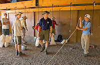 Photo story of Philmont Scout Ranch in Cimarron, New Mexico, taken during a Boy Scout Troop backpack trip in the summer of 2013. Photo is part of a comprehensive picture package which shows in-depth photography of a BSA Ventures crew on a trek. In this photo, a BSA Venture crew  gathers up all of their issued equipment at base camp at the Philmont Scout Ranch,  in Cimarron, New Mexico.<br /> <br /> Photo by travel photograph: PatrickschneiderPhoto.com