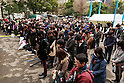 People take part in a moment of silence at 2:46 pm on the fifth anniversary of the Great East Japan Earthquake and Tsunami disaster at the Peace on Earth memorial ceremony in Hibiya Park on March 11, 2016, Tokyo, Japan. Almost 19,000 people lost their lives as a result of the magnitude 9.0 earthquake and subsequent tsunami that hit Japan's north east coast 5 years ago. Five years after the event some 174,000 survivors are still in temporary accommodation. This includes nearly 100,000 from Fukushima who have not been able to return home as a result of the effects of the tsunami and nuclear catastrophe that ensued. (Photo by Rodrigo Reyes Marin/AFLO)