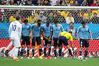 Referee Carlos Velasco Carballo marks a line with the vanishing spray