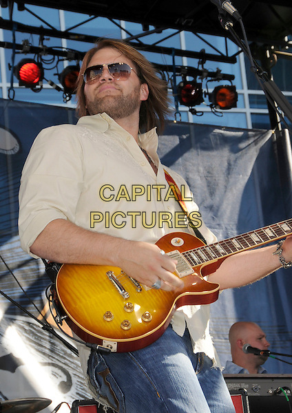 JAMES OTTO.CMA Music Festival Block Party held at the Chevy Plaza, Nashville, Tennessee, USA..June 4th, 2008.stage concert live gig music performance half length guitar sunglasses shades yellow shirt stubble facial hair .CAP/ADM/LF.©Laura Farr/AdMedia/Capital Pictures.