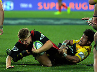 Ardie Savea tackles Jack Goodhue during the Super Rugby match between the Hurricanes and Crusaders at Westpac Stadium in Wellington, New Zealand on Saturday, 15 July 2017. Photo: Dave Lintott / lintottphoto.co.nz