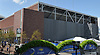 The exterior of newly-reopened Louis Armstrong Stadium is seen from the grounds of the USTA Billie Jean King National Tennis Center in Corona, NY on Wednesday, Aug. 22, 2018. The 14,000 seat stadium which features a retractable roof will host US Open matches starting Monday, Aug. 27.