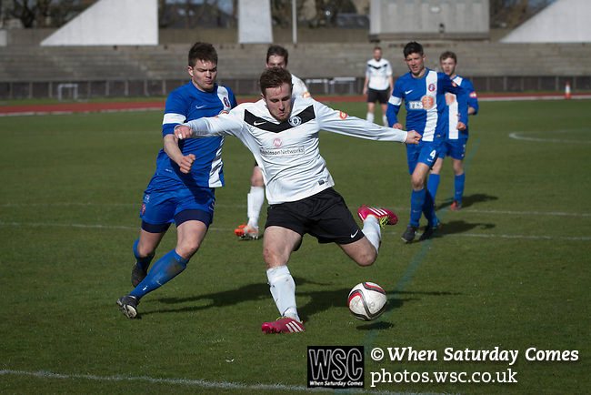 Edinburgh City v Spartans, 11/04/2015. Commonwealth Stadium, Scottish Lowland League. Home club striker Ross Allum shoots for goal at the Commonwealth Stadium at Meadowbank during the Scottish Lowland League match between Edinburgh City (white shirts) and city rivals Spartans, which was won by the hosts by 2-0. Edinburgh City were the 2014-15 league champions and progressed to a play-off to decide whether there would be a club promoted to the Scottish League for the first time in its history. The Commonwealth Stadium hosted Scottish League matches between 1974-95 when Meadowbank Thistle played there. Photo by Colin McPherson.