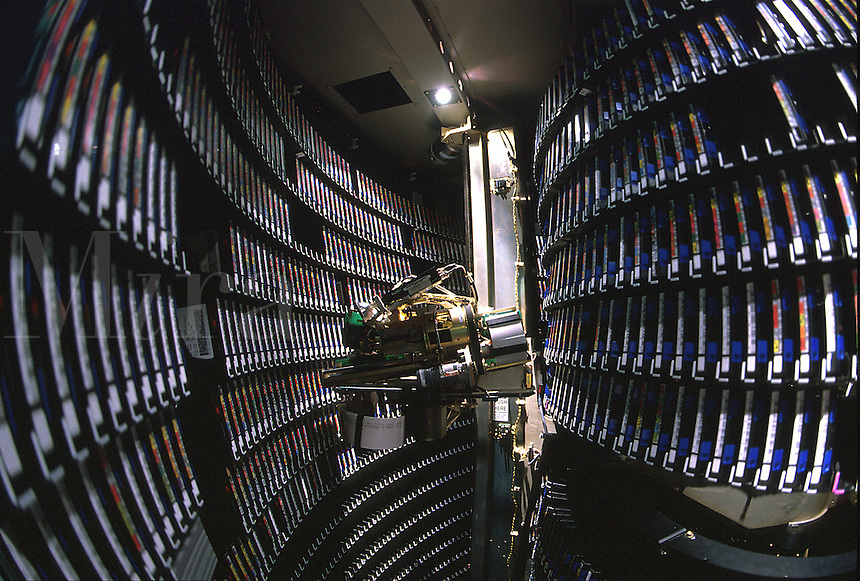 Computerized robotic retrieval system for a data library.