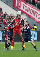 21 April 2012: Toronto FC foward/midfielder Ryan Johnson #9 battles for a ball with Chicago Fire defender Dan Gargan #3 and Chicago Fire midfielder Logan Pause #12 during a game between the Chicago Fire and Toronto FC at BMO Field in Toronto..The Chicago Fire won 3-2....