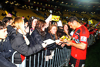 Dan Carter signs autographs. Super 15 rugby match - Crusaders v Hurricanes at Westpac Stadium, Wellington, New Zealand on Saturday, 18 June 2011. Photo: Dave Lintott / lintottphoto.co.nz