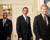 Washington, D.C. - June 22, 2009 -- United States President Barack Obama enters in the Diplomatic Reception Room to deliver a statement on the historic agreement to lower drug costs for seniors  at the White House on Monday, June 22, 2009.  From left to right: Barry Rand, President, American Association of Retired Persons (AARP); President Obama; and U.S. Senator Max Baucus (Democrat of Montana)..Credit: Ron Sachs - Pool via CNP