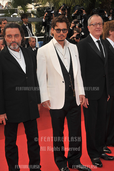 "Johnny Depp, Ian McShane & Geoffrey Rush at the gala screening for their movie ""Pirates of the Caribbean: On Stranger Tides"" at the 64th Festival de Cannes..May 14, 2011  Cannes, France.Picture: Paul Smith / Featureflash"