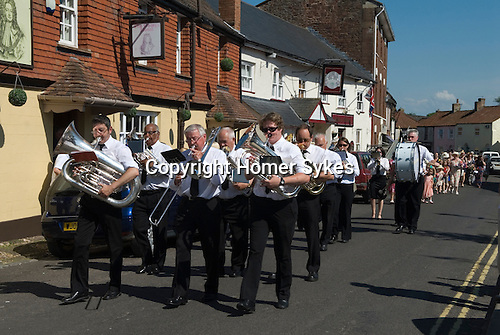 Stowey Female Friendly Society ( The Womens Walk ) Club Day. Local women and flower girls walk from the village to the grave of Tom Poole at St Marys Church and then following behind the  silver band to the Village Hall for a cream tea. Nether Stowey Somerset UK 2014.
