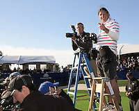 28 JAN 13  Photographer Pat Haggerty getting ready for his Cirque de Solei audition after Monday's Final round of The Farmers Insurance Open at The Torrey Pines Golf Course in La Jolla, California.(photo:  kenneth e.dennis / kendennisphoto.com)