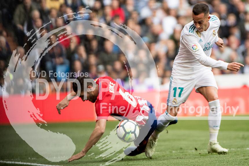 Real Madrid's Spanish midfielder Lucas Vazquez; Atletico Madrid's Spanish midfielder Koke<br /> Spanish league football match Real Madrid vs Atletico de Madrid at the Santiago Bernabeu stadium in Madrid on April 8, 2018.