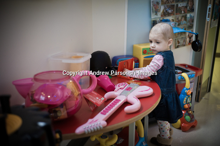Yasmin Parsons plays in the play room on  her last planned visit to Great Ormond Street Hospital before Christmas after being diagnosed with Leukaemia in August, 2012, Photo By Andrew Parsons / i-Images