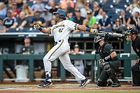 Michigan Wolverines designated hitter Jordan Nwogu (42) follows through on his swing against the Vanderbilt Commodores during Game 2 of the NCAA College World Series Finals on June 25, 2019 at TD Ameritrade Park in Omaha, Nebraska. Vanderbilt defeated Michigan 4-1. (Andrew Woolley/Four Seam Images)