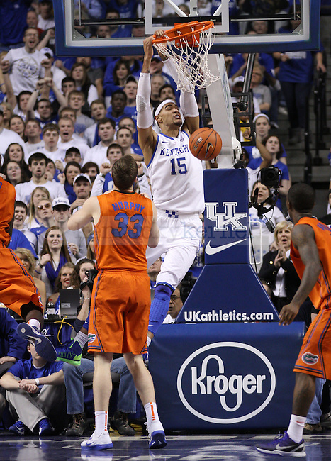 UK's Willie Cauley-Stein holds on the the rim after a dunk. in Lexington, Ky., on Saturday, March, 9, 2013. Photo by James Holt | Staff