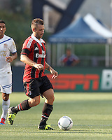 AC Milan forward Antonio Cassano (99) dribbles at midfield. In an international friendly, AC Milan defeated C.D. Olimpia, 3-1, at Gillette Stadium on August 4, 2012.