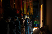 Huanggang, Hebei province, China - Buddhists perform morning rites at the ancient Anguo Temple, October 2014.