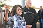 The Rev. Shalom Agtarap leads prayer outside the Federal Detention Center in Seatac, Washington, during a June 24 prayer vigil in support of immigrant parents inside the prison who've been separated from their children. Agtarap is associate director for vitality and innovation for the Greater Northwest Episcopal Area of the United Methodist Church.