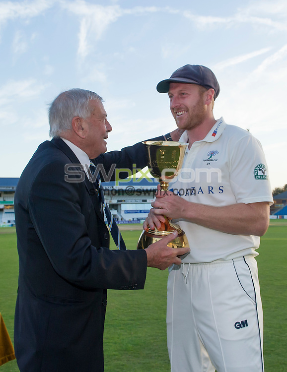 Picture by Allan McKenzie/SWpix.com - 26/09/2014 - Cricket - LV County Championship Div One - Yorkshire County Cricket Club v Somerset County Cricket Club - Headingley Cricket Ground, Leeds, England - Yorkshire Chairman Harold 'Dickie' Bird presents the trophy to Andrew Gale.