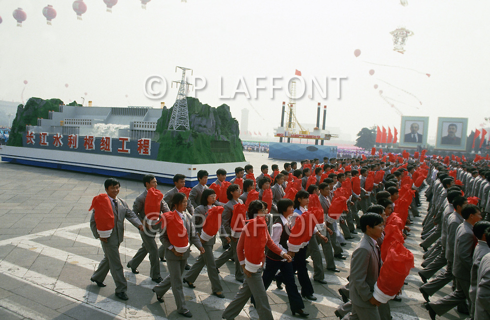 Beijing, China. October 1st, 1984. This huge parade is for the celebration of the 35th Anniversary of the Chinese Revolution. Many huge floats dedicated to Space, Aviation, and Exploration.