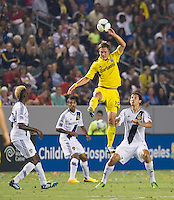 CARSON, CA - July 4, 2013: Columbus Crew midfielder Konrad Warzycha (19) goes up for a ball during the LA Galaxy vs Columbus Crew match at the StubHub Center in Carson, California. Final score, LA Galaxy 2, Columbus Crew 1.