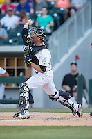 Charlotte Knights catcher Kevan Smith (32) makes a throw to second base against the Indianapolis Indians at BB&T BallPark on June 20, 2015 in Charlotte, North Carolina.  The Knights defeated the Indians 6-5 in 12 innings.  (Brian Westerholt/Four Seam Images)
