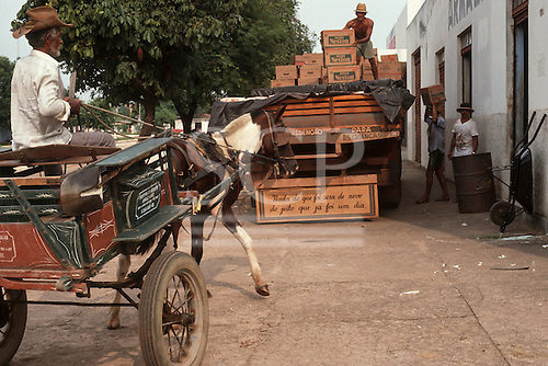 Redencao, Para State, Brazil. Horse and cart, men loading a truck with 'Nada do que foi sera de novo de jeito que ja foi um dia'; 'Nothing of what has been will be again as it once was'.