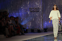 PORTO, PORTUGAL, 25.10.2014 - FASHION WEEK PORTUGAL - Modelo desfila para Spring / Summer 2015 criação do designer Português Carlos Gil durante a edição 35rd de Portugal Fashion Week, na Alfândega do Porto, Portugal, em 25 de outubro de 2014 (Foto: Pedro Lopes/ Brazil Photo Press).