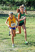 Ste. Genevieve sophomore Mia Jerman battles Francis Howell's Maddi Leigh up the final 250 meters on her way to a 5th place finish in 19:05, beating Leigh and helping the Lady Hunters to the team title in the 4A Varsity 5k race at the 2013 Hancock Cross Country Invitational in St. Louis, Saturday, September 28.