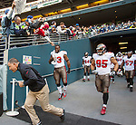 Tampa Bay Buccaneers Head Coach Greg Schiano leads his tea out of the tunnel before kickoff against the Seattle Seahawks  at CenturyLink Field in Seattle, Washington on  November 3, 2013.  The Seahawks beat the Buccaneers 27-24 in overtime. ©2013. Jim Bryant. All Rights Reserved.
