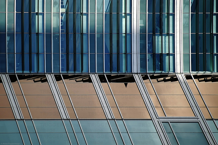 A modern facade with a series of tinted windows.