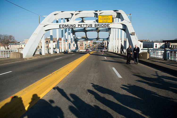 "UNITED STATES - FEBRUARY 14: Rep. John Lewis, D-Ga., walks across the Edmund Pettus Bridge with Bob Schieffer of CBS News in Selma, Ala., on Saturday, Feb. 14, 2015. Rep. Lewis was beaten by police on the bridge on ""Bloody Sunday"" 50 years ago on March 7, 1965, during an attempted march for voting rights from Selma to Montgomery. (Photo By Bill Clark/CQ Roll Call)"