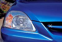 Blue Car. Auto, Automobile, Front Headlight, Close up, Detail,