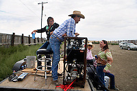 Janelle Nelson (right) speaks with the mechanical bull operator at the Mechanical Bull-A-Rama at the Whoa Arena in Valier, Montana, USA.  The event, organized by Janelle Nelson, was a benefit for local youth rodeo participants and the local food bank.