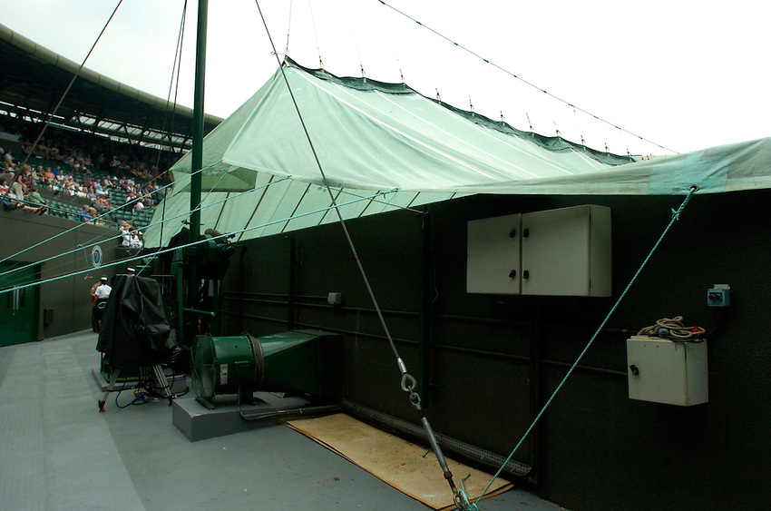 Photo: Richard Lane..Wimbledon Championships. 05/07/2006. .Court covers on Court One.