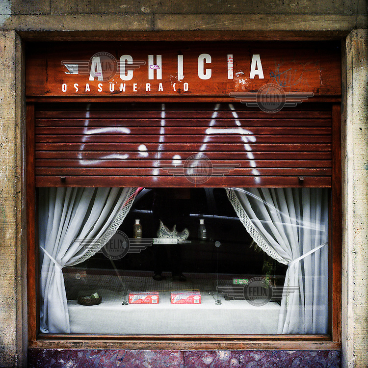 ETA graffiti painted onto the shutters of a restaurant....
