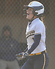 Francesca Cuttitta #11, Massapequa first baseman, reacts after connecting for her second two-run homer of the afternoon in the top of the seventh inning of a Nassau County AA-1 varsity softball game against host East Meadow on Wednesday, April 11, 2018. Massapequa won by a score of 8-4.