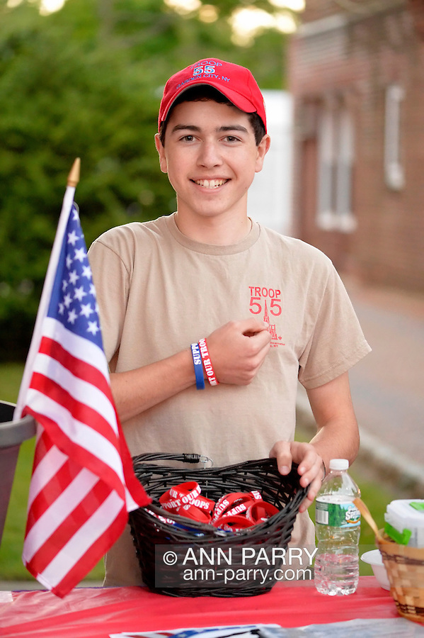 Garden City, New York, U.S. - June 6, 2014 -  DANNY LaROSE, a Boy Scout in Garden City Troop 55, is collecting donations for his Eagle Scout project, which includes providing a shed, picnic table and more for United Veterans, at the 17th Annual Garden City Belmont Stakes Festival, celebrating the 146th running of Belmont Stakes at nearby Elmont the next day. There was street festival family fun with live bands, food, pony rides and more, and a main sponsor of this Long Island night event was The New York Racing Association Inc.