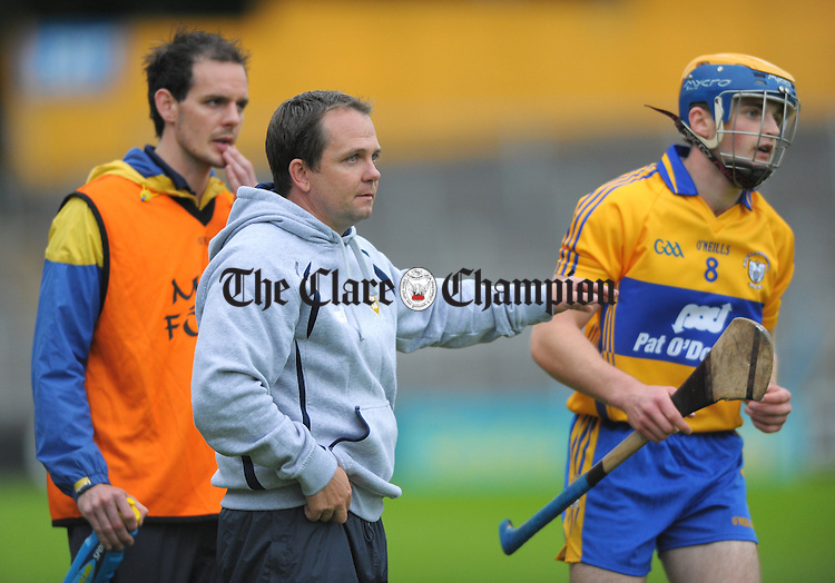 Clare manager Davy Fitzgerald flanked by Paul Kinnerk instructing Seadna Morey during the final stages of the All-Ireland senior championship qualifier phase 3 game at Semple Stadium. Photograph by John Kelly.