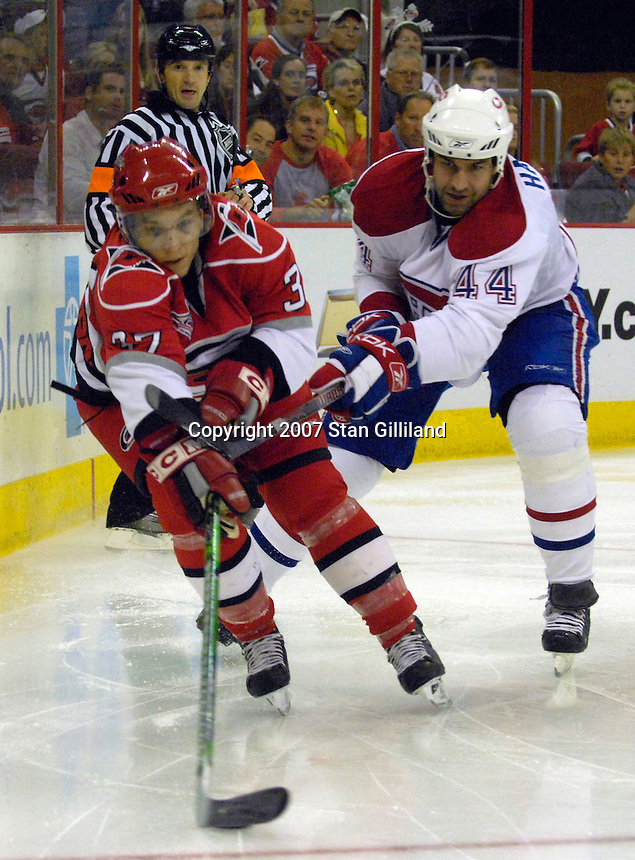 Carolina Hurricanes' Keith Aucoin (37) is followed by Montreal Canadien defenseman Roman Hamrlik (44) during their game Friday, Oct. 26, 2007 in Raleigh, NC. The Canadiens won 7-4.