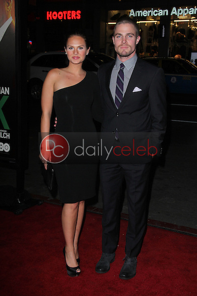 """Stephen Amell and Cassandra Jean<br /> at the premiere of HBO's """"LUCK,"""" Chinese Theater, Hollywood, CA 01-25-12<br /> David Edwards/DailyCeleb.com 818-249-4998"""
