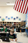 November 15, 2011. Mooresville, NC.. Jackson Brown, a 5th grader at East Mooresville Intermediate School, works on an in class science lesson on his school issued laptop.. The Mooresville school system has become nationally known for being on the cutting edge of using technology as an educational tool. Starting in 3rd grade, each student is issued their own laptop that they will use in class and at home to further their learning.